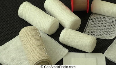 Bandages and plasters on a black background