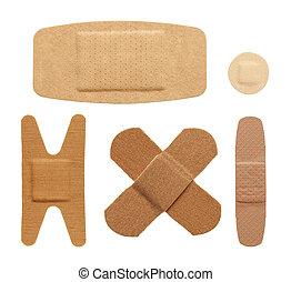 Bandages - Various bandage shapes sizes and colors isolated...