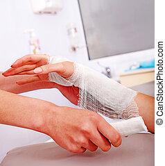 Bandaging patient in hospital.