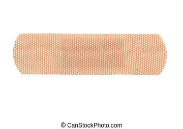 macro of a skin toned bandage isolated on white background
