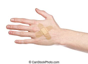 Bandaid on a hand