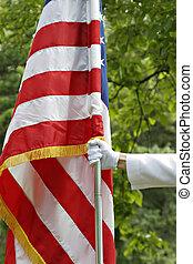 bandeira americana, segurando mão