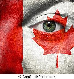 bandiera, dipinto, su, faccia, con, occhio verde, mostrare, canada, sostegno, in, sport, fiammiferi