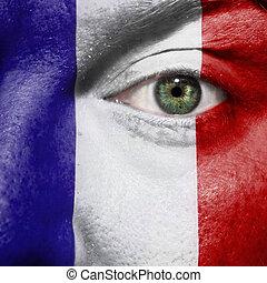 bandiera, dipinto, su, faccia, con, occhio verde, mostrare, francia, sostegno