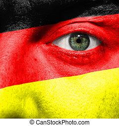 bandiera, dipinto, su, faccia, con, occhio verde, mostrare, germania, sostegno