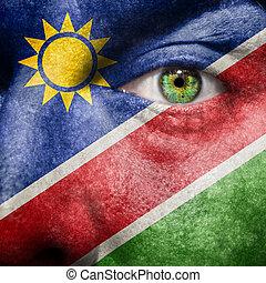 bandiera, dipinto, su, faccia, con, occhio verde, mostrare, namibia, sostegno