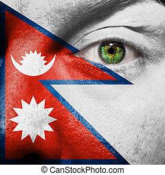 bandiera, dipinto, su, faccia, con, occhio verde, mostrare, nepal, sostegno