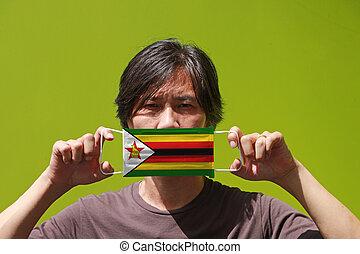 bandiera, mano, verde, uomo maschera, esso, modello, igienico, fondo., suo, coperchio, aumenti, faccia, zimbabwe