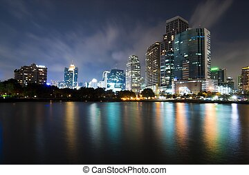 Bangkok city downtown at night with reflection of skyline, ...