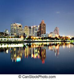 Bangkok city downtown at night with reflection of skyline, Bangkok