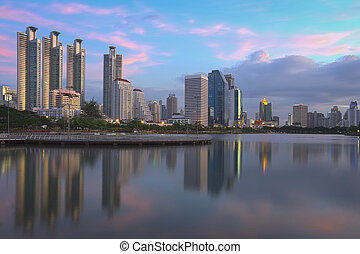 Bangkok city office building with water reflection