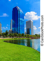 Bangkok city on blue sky with cloud at Benchakitti Park,Thailand.