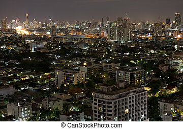 Bangkok city scrapers with high building at night time