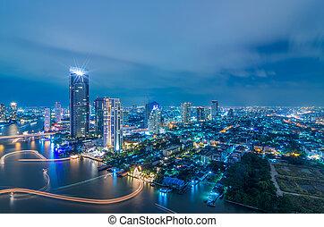 Landscape Bangkok city Modern building at twilight, high angle.