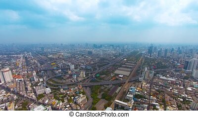 Bangkok cityscape, Thailand's capital city, on a, hazy day, with a highway junction