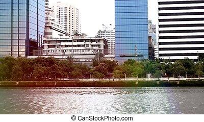 Bangkok cityscape with pond.