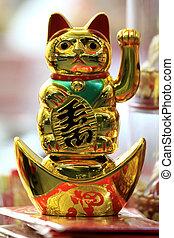 BANGKOK - JANUARY 23 : Chinese New Year 2012 - Waving Gold Cat in Chinatown, Bangkok, Thailand