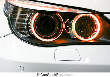 Headlights of a 7 series BMW car - BANGKOK - MARCH 27:...