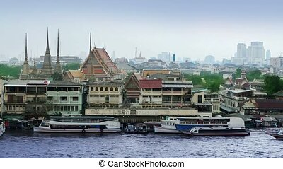 Bangkok river view from wat phraya. Grand palace is seen