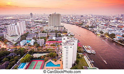Bangkok Skyline and Chao Phraya River at Sunset in Thailand