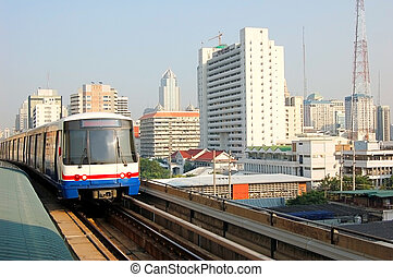 Bangkok skytrain approaching the downtown Siam station