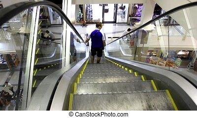 Bangkok. Thailand. 31 july 2014. Escalator with man in a big mall. HD. 1920x1080