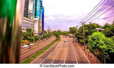 BANGKOK, THAILAND, 4 AUGUST 2014, Traffic on a road in the city centre. 4k. Timelapse speed up