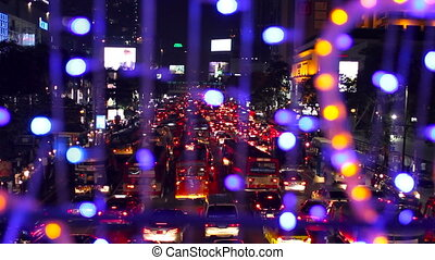 BANGKOK, THAILAND - Aerial view on road. Road traffic in night from high above. View from garland with colorful light bulbs.