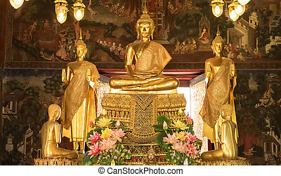 Details of golden buddha statue with tales of the lord Buddha's former births