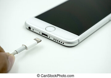 close up image of the new apple iphone 6s with the charging...