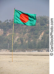 Bangladesh Flag Waving on a Blue Sky With Hill Background