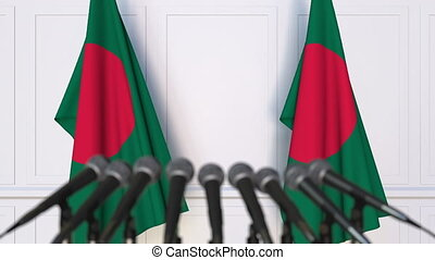 Bangladeshi official press conference with flags of...