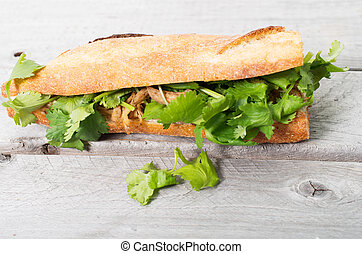 Banh Mi, Vietnamese sandwich filled with shredded chicken...