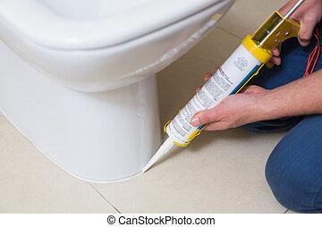 banheiro, banheiro, encanador, cartucho, silicone, afixando
