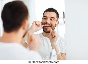 banheiro, fio dental, dentes limpando, homem