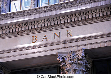 Old building with letters bank on it