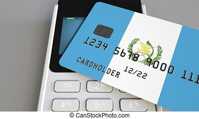 Plastic bank card featuring state flag and payment terminal