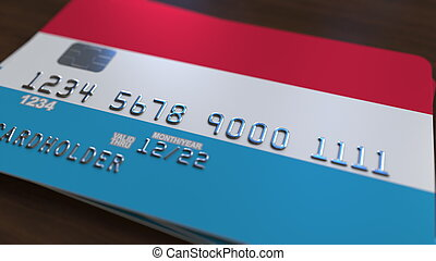 Bank card featuring flag of Luxembourg. Luxembourgian ...
