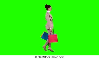 Bank employee girl goes shopping in the store. Green screen...
