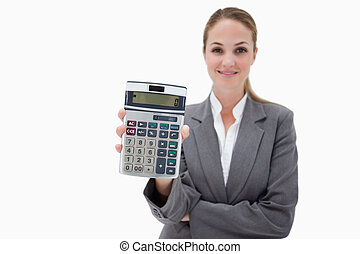 Bank employee showing her pocket calculator against a white...