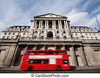 Bank of England with motion blur of passing double decker...