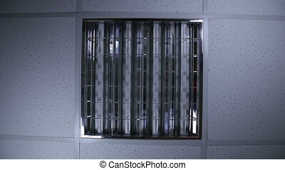 Bank of fluorescent lights in office
