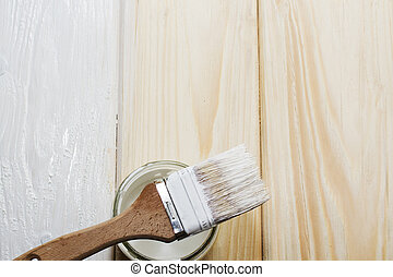 Bank paints and brush on a wooden background.