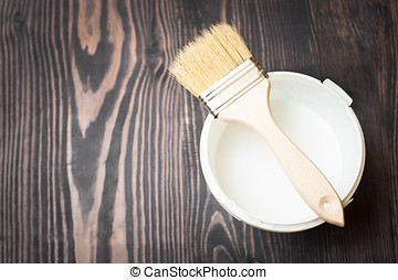 Bank paints and brush on a wooden background