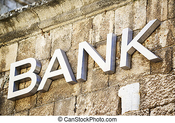 Bank sign carved in stone on building