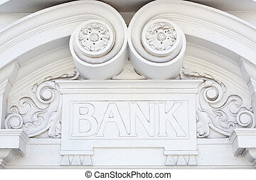 Bank sign in stone on facade