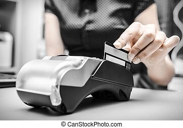 Bank terminal - Female hand holding plastic card in payment
