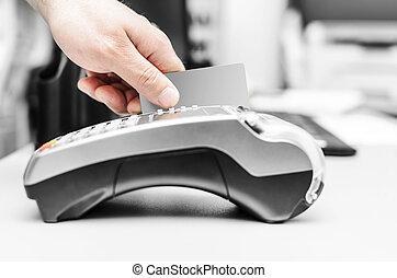 Bank terminal. - Debit card swiping on bank terminal....