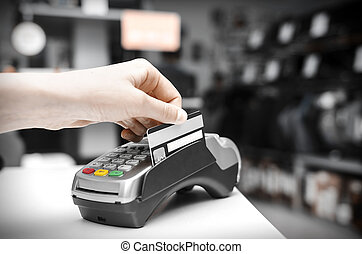 Bank terminal - Hand holding  bank terminal and plastic card