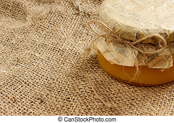 bank with honey on burlap. Side view